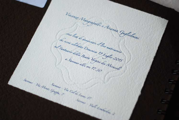 Traditional wedding card with watermarked initials and frame